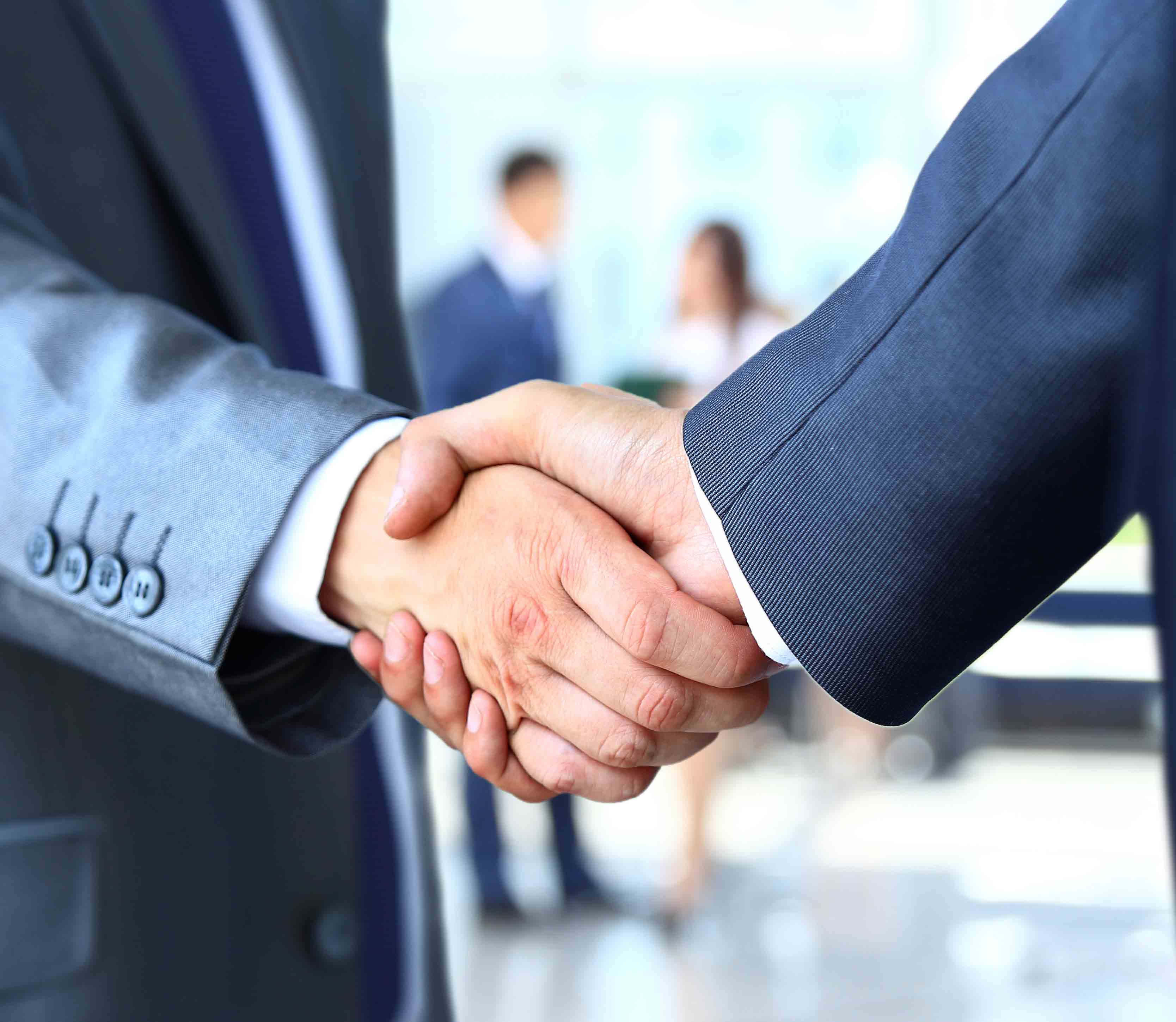 Businessmen sealing a deal with a handshake