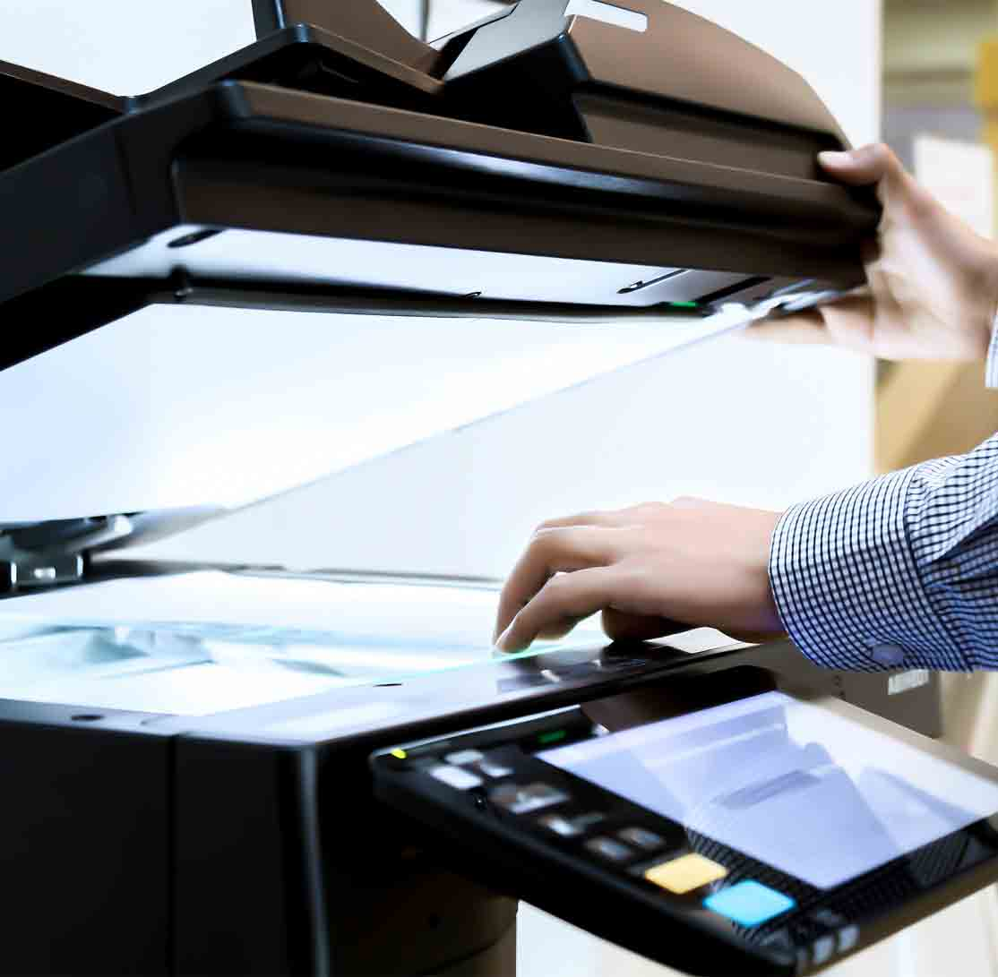office worker using the printer to scan documents