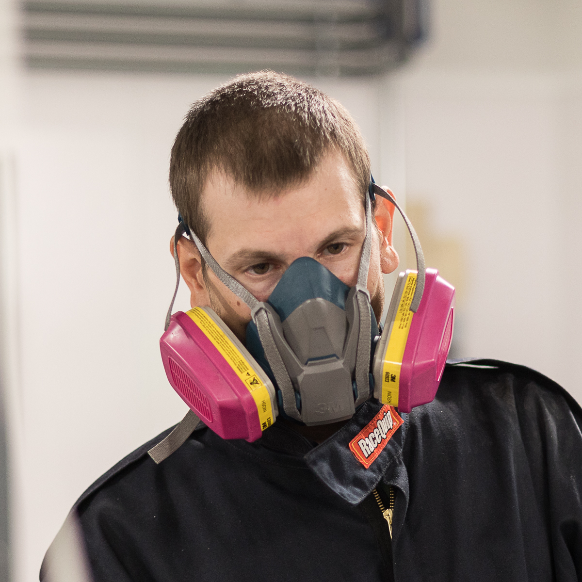 Image of production worker in gas mask