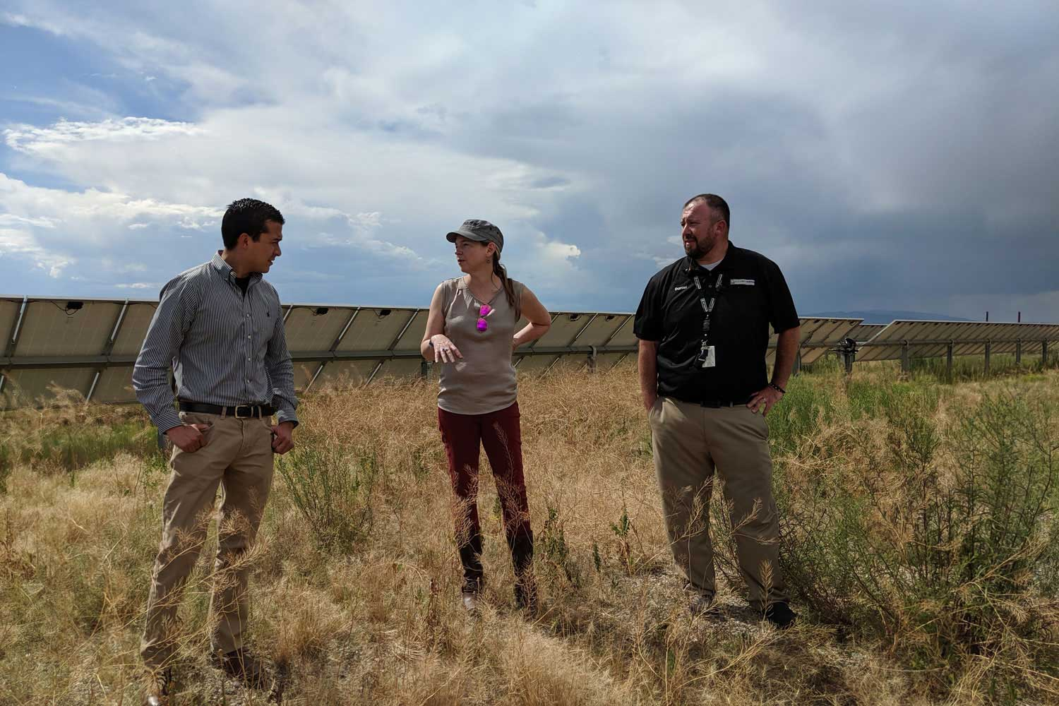 astrid from camus in a solar field with utility representatives