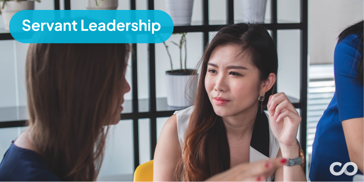 An image showing a leader listening to one of her employees.