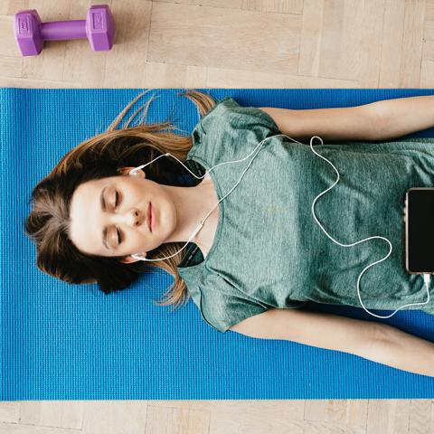 Lady lying on a yoga mat