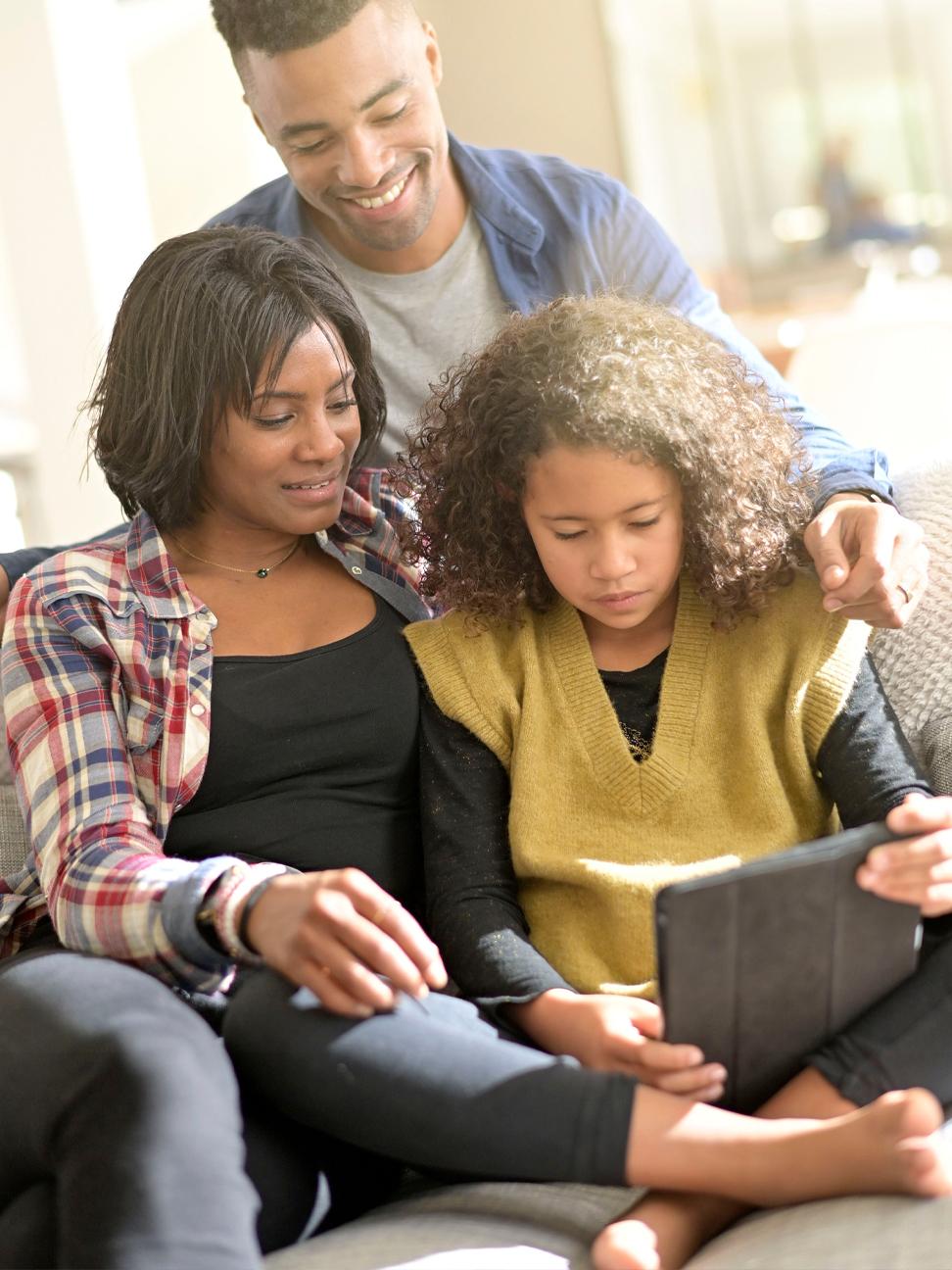 Family looking at an ipad