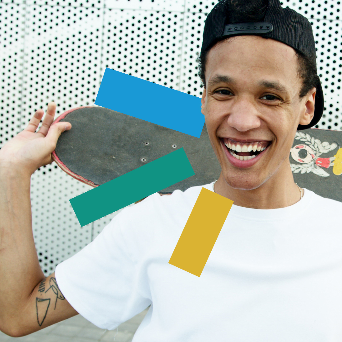 Man Laughing and holding a skateboard