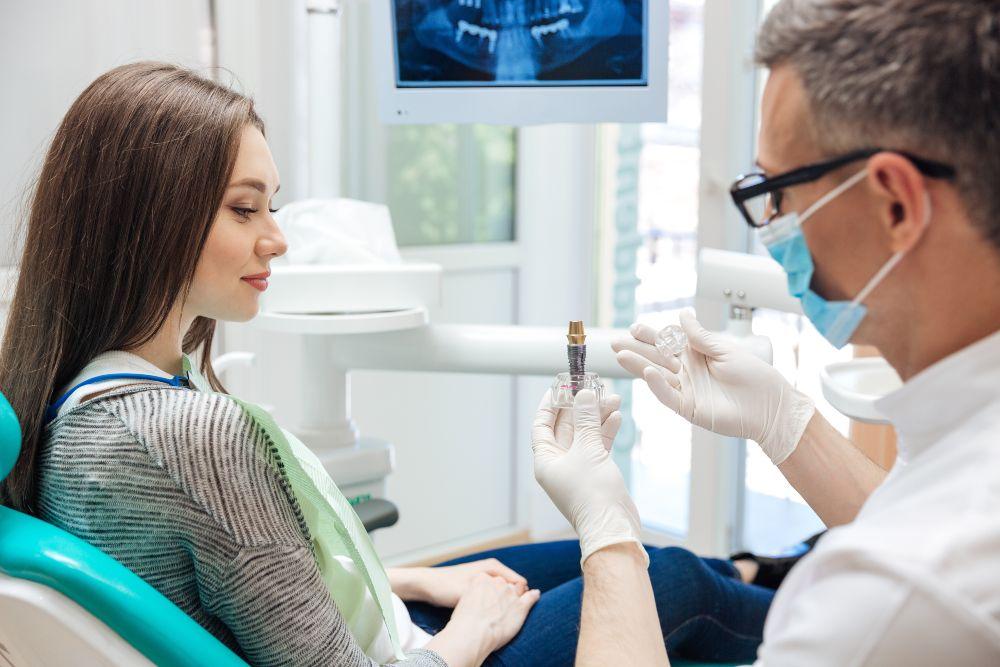 dentist showing dental implant