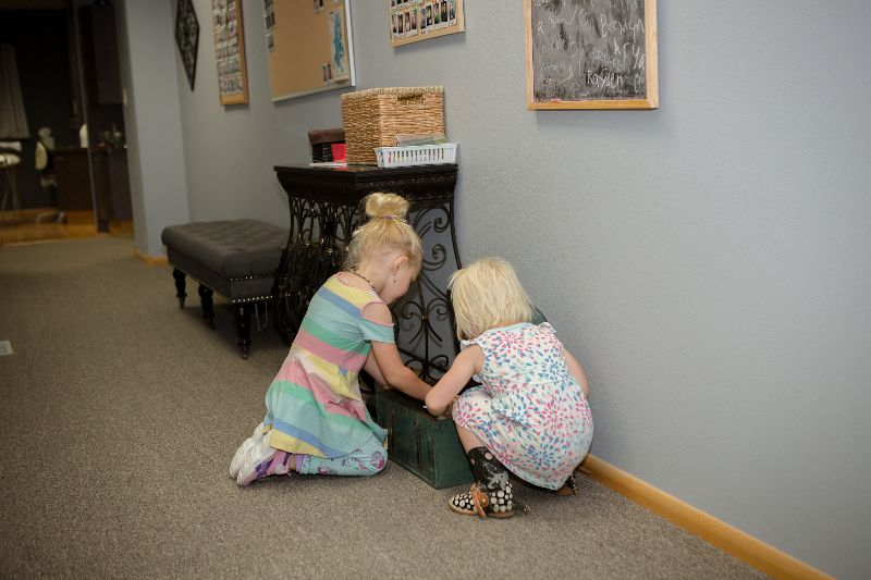 kids picking out toys from the prize chest