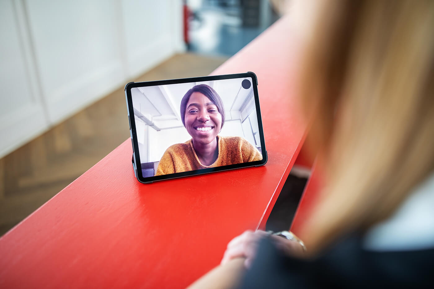 woman smiling whilst on a video call