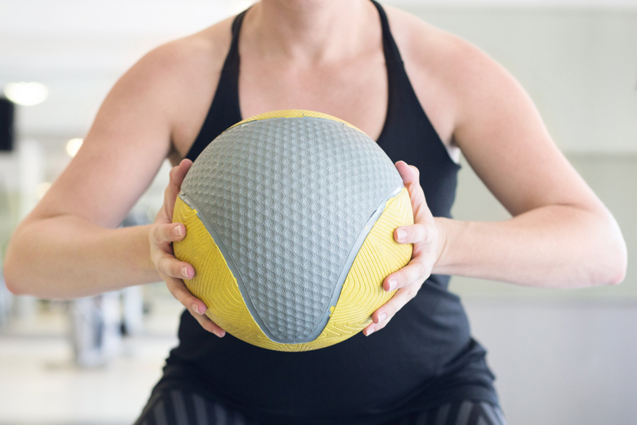 A woman strength training to get in shape