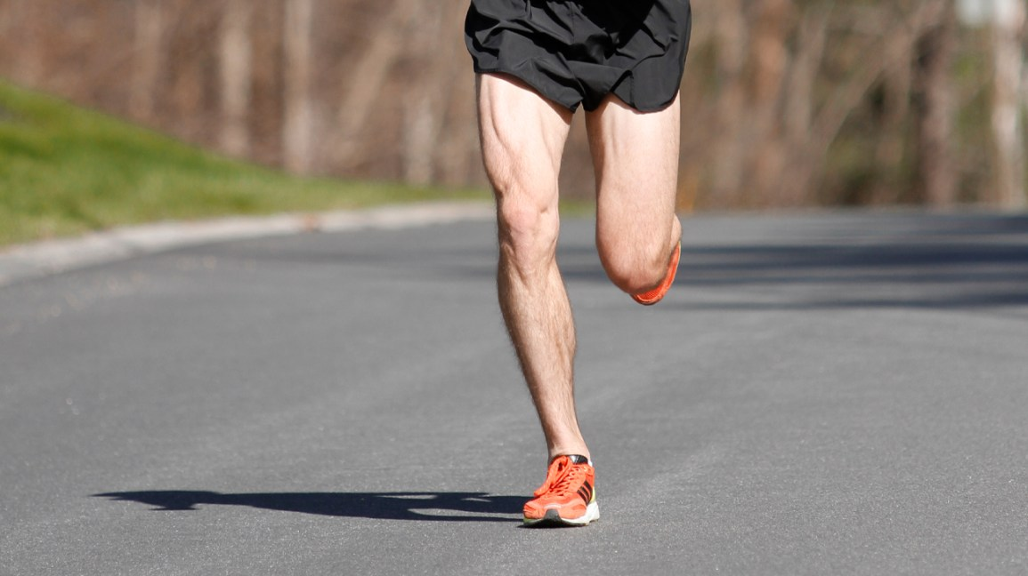 Athletic man running outside
