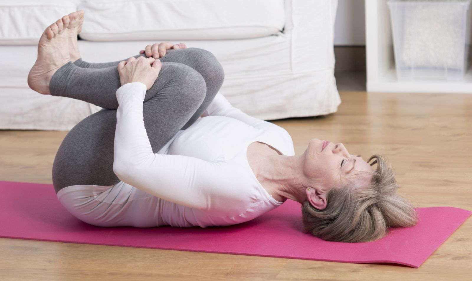 Woman exercising back after injury