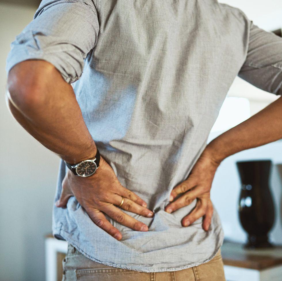 Man demonstrating lower back pain