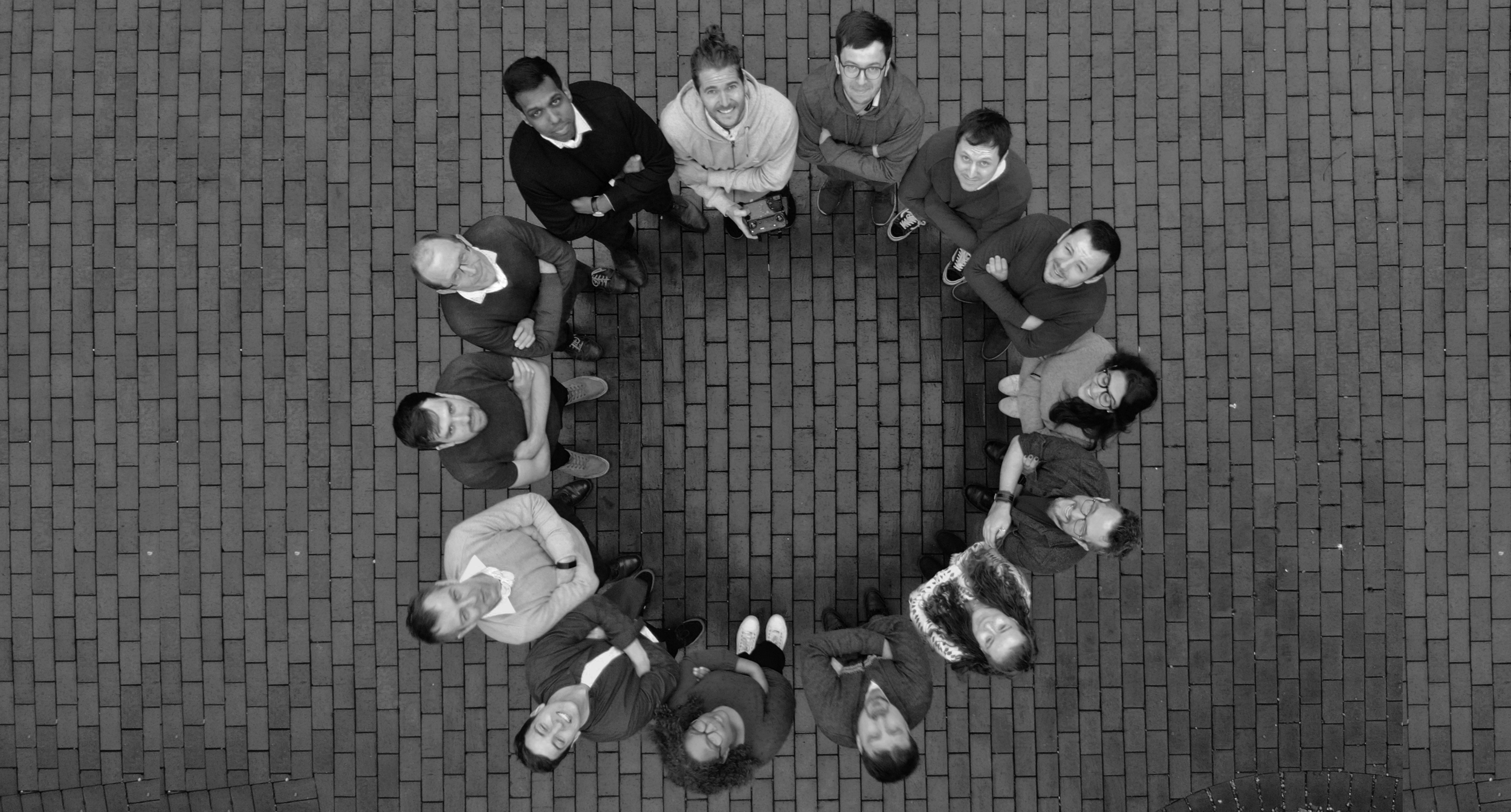 An overhead image showing the WealthKernel team stood in a circle