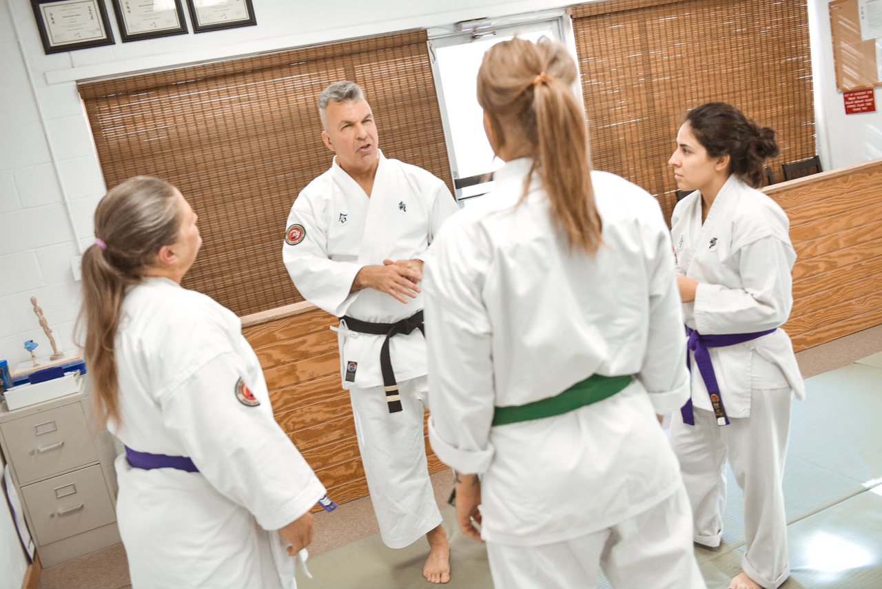 The Sr. NGA Instructor is seen discussing topics of women's self defense.