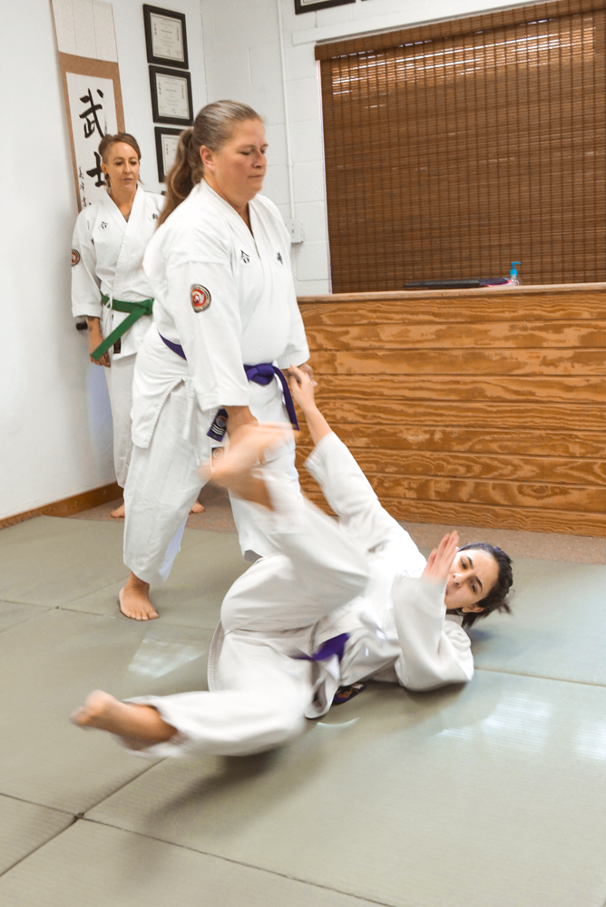 An NGA Green Belt student is seen practicing the Hip Throw classical technique.