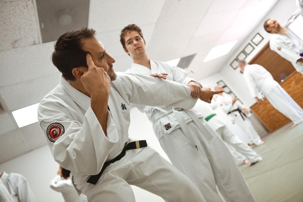 An NGA Black Belt instructor demonstrates the logic of the Arm Bar.