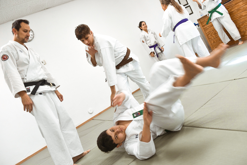 An NGA Brown Belt is seen demonstrating his abilities with the Bear Hug Throw classical technique.