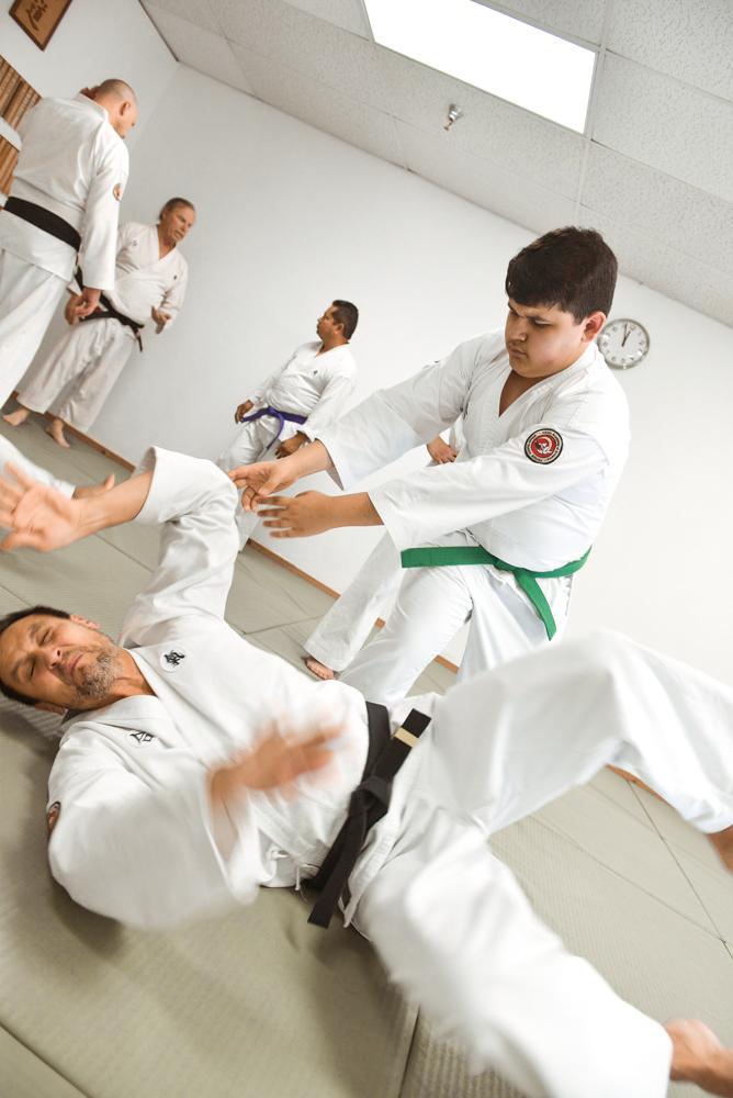 An NGA Green Belt is seen performing throw against their partner (uke).