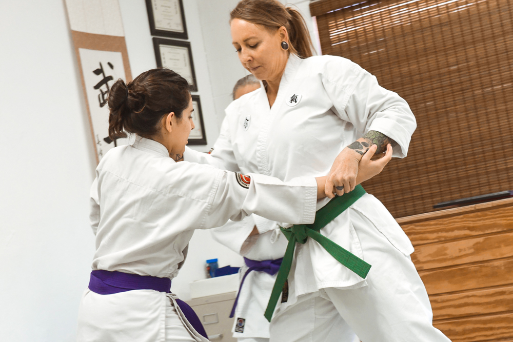 Two NGA students are seen practicing the Elbow Chop classical technique.