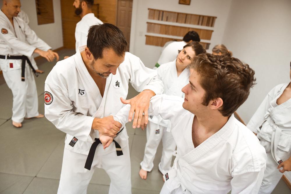 An NGA Black Belt instructor demonstrates various scenarios to apply  the Arm Bar application.