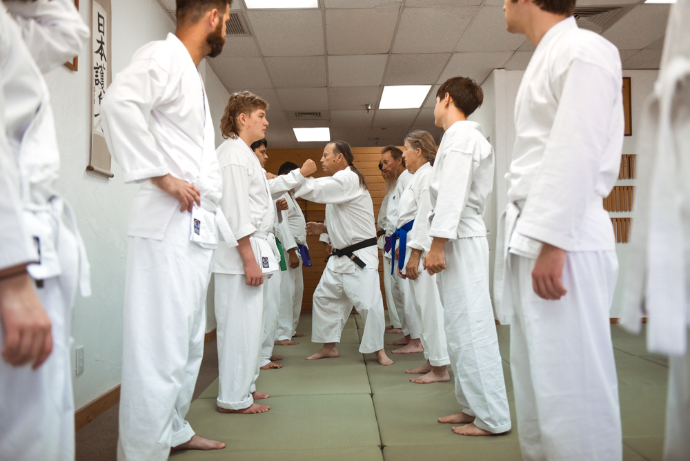 An NGA Black Belt instructor is seen participating in the Gauntlet Line.