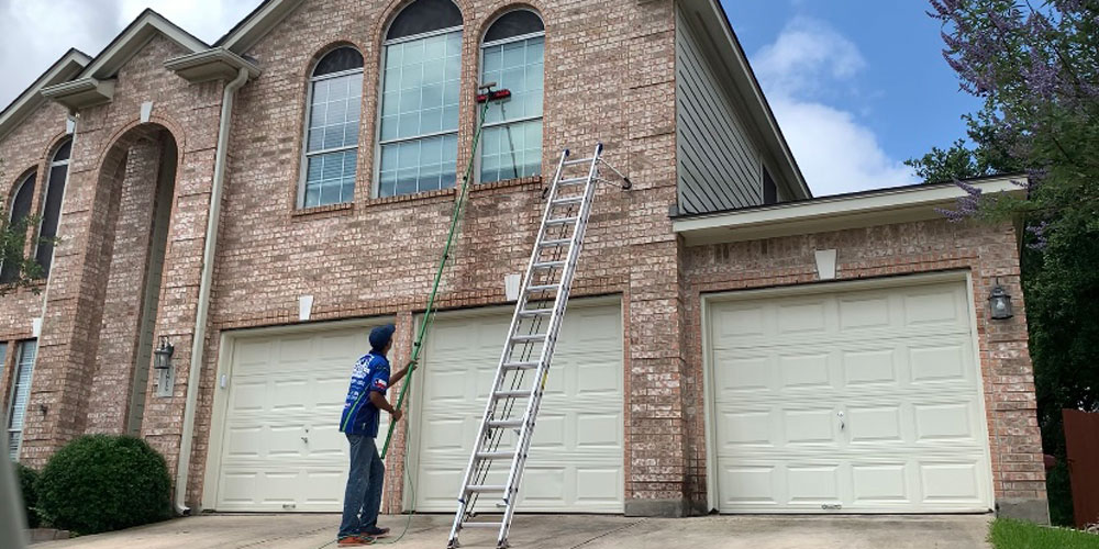 Window cleaning at a residential property in San Antonio.