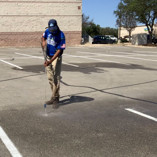 Commercial cleaning of a parking lot.