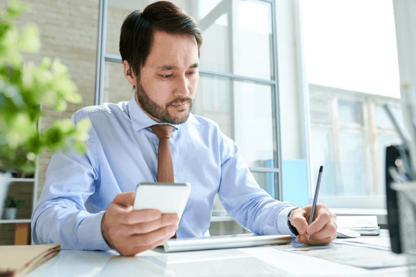 Accountant working with mobile in office
