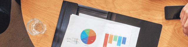 Clipboard with data and pie chart to show industry insights
