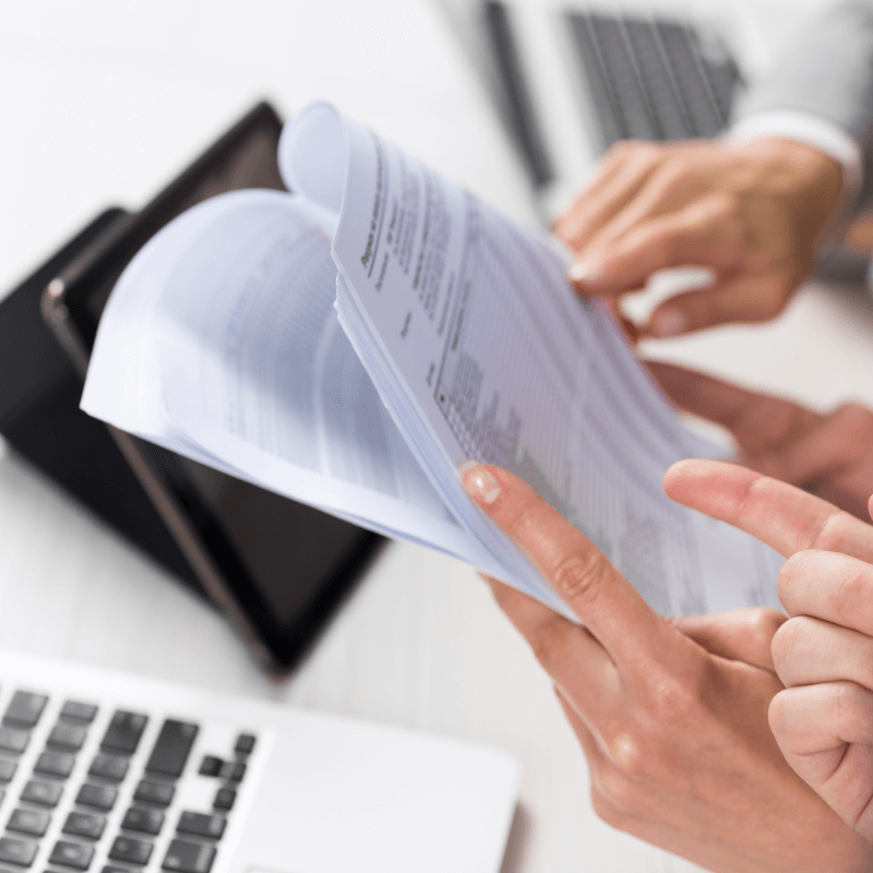 Payroll officer holding accounting paperwork