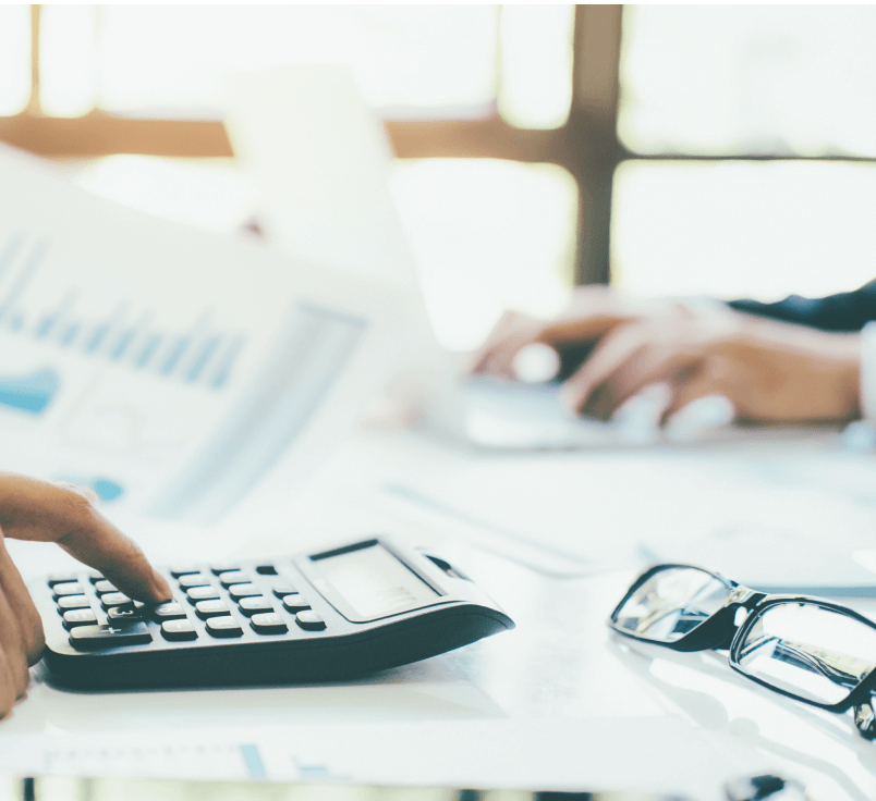 Accountants using a calculator