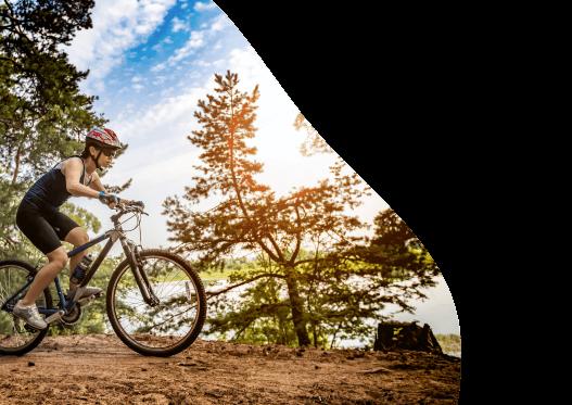 Woman cycling on bike trail