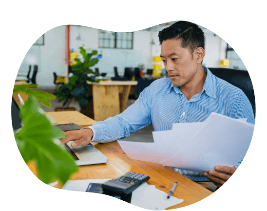 Accountant working in an office holding paperwork
