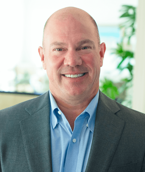A headshot of Matt Wilson, s Certified Senior Advisor, wearing a suit.