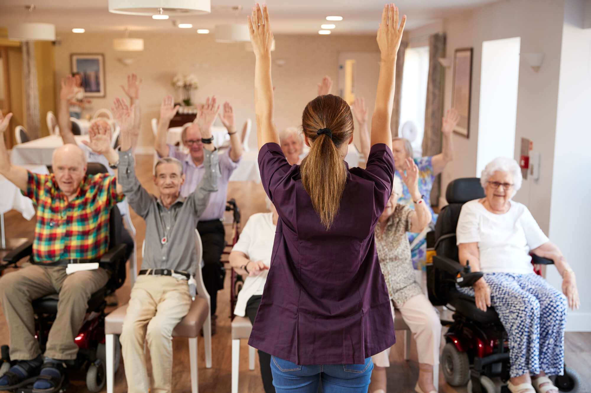 Group of elderly people doing exercises at assisted living oklahoma