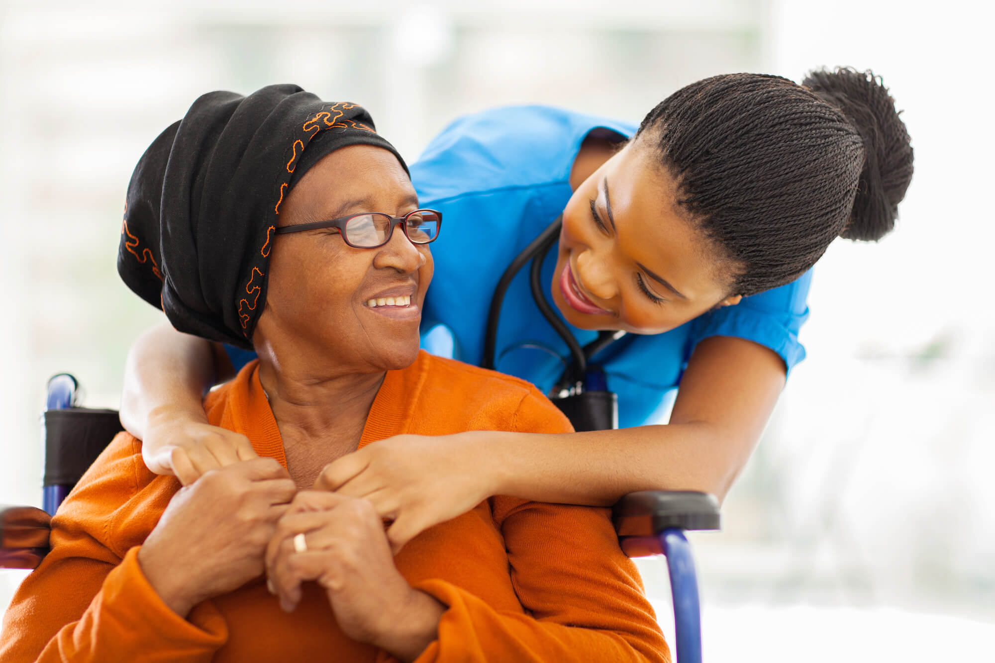 Nurse caring for an elderly woman at assisted living oklahoma