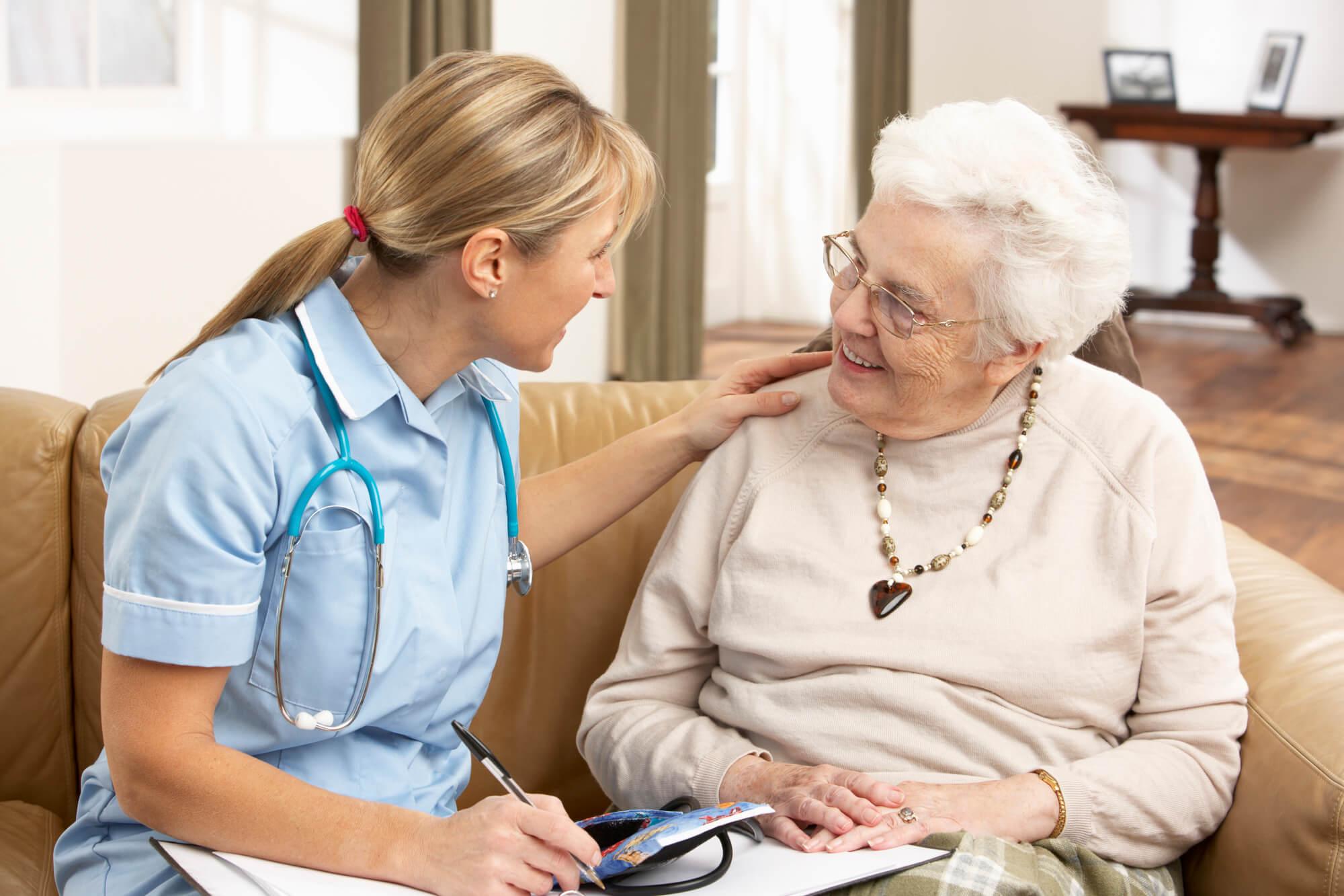 A caretaker helping a senior lady at senior living in oklahoma city