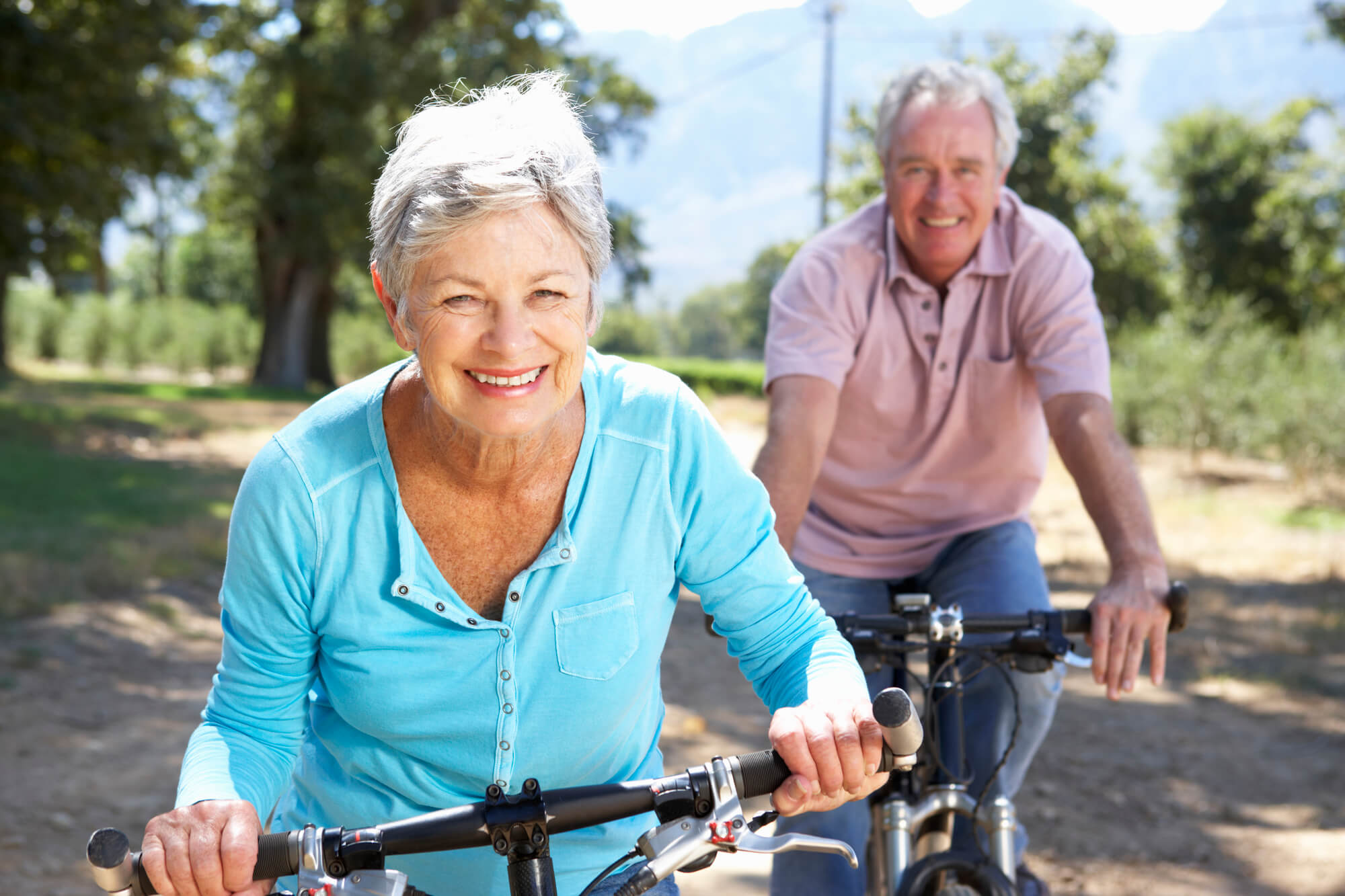 Two elderly people riding bicycles at independent living Oklahoma City