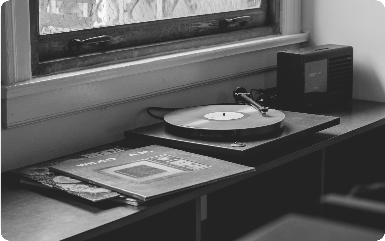 Record player sitting in front of open window