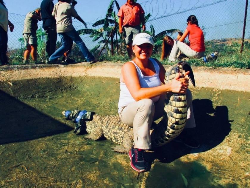 Erica DVM with a crocodile