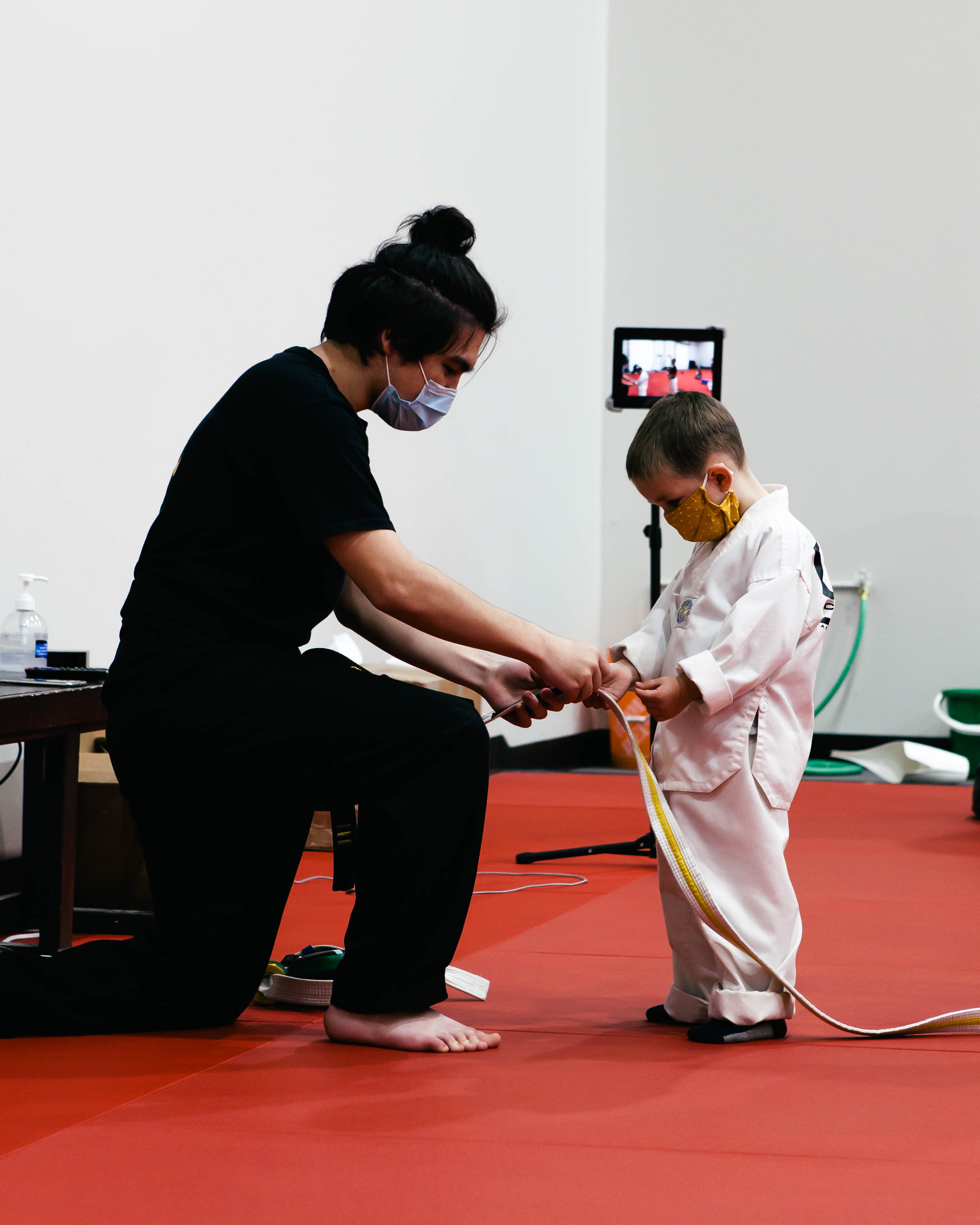 A trainer instructing kid