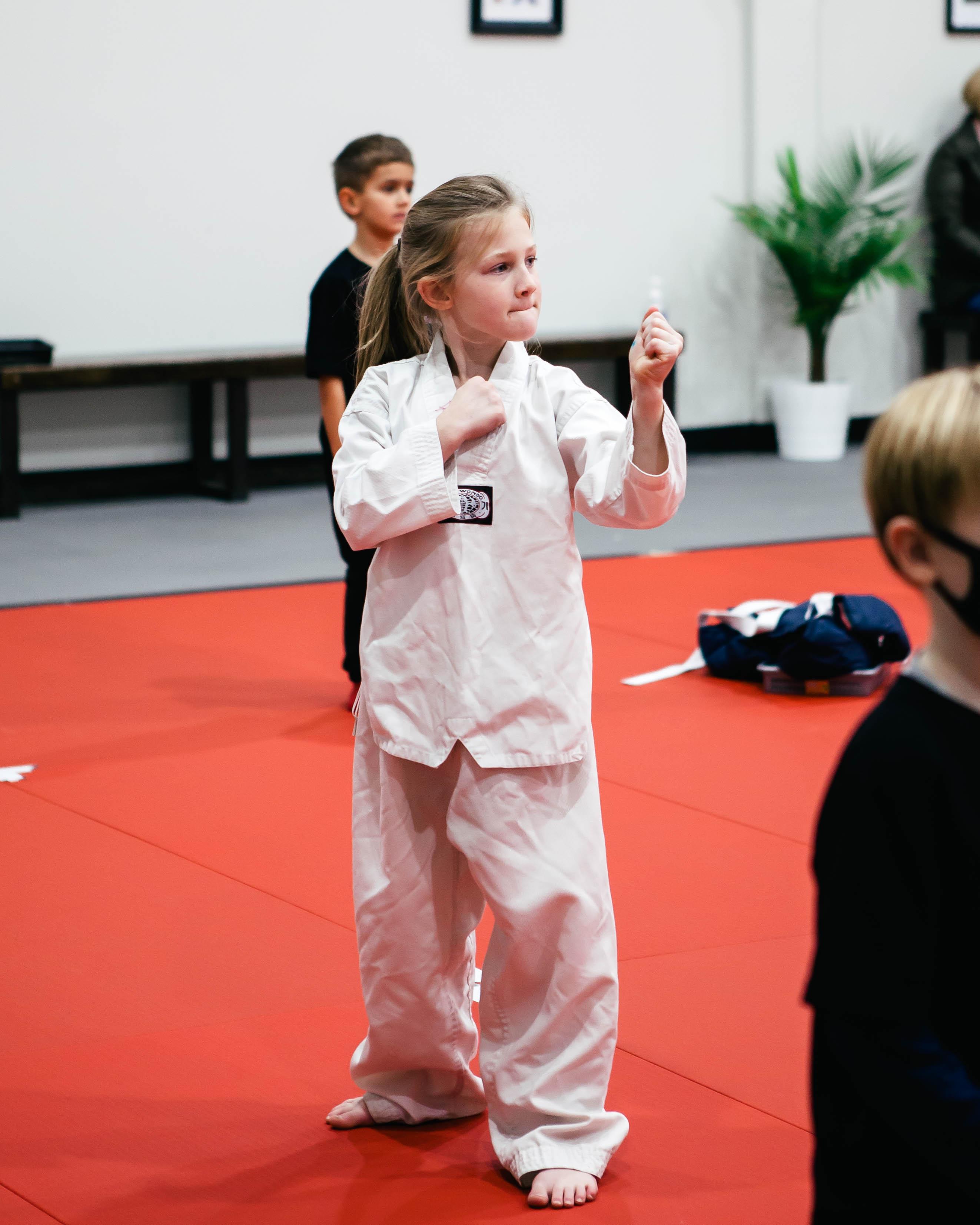 A girl training Taekwondo