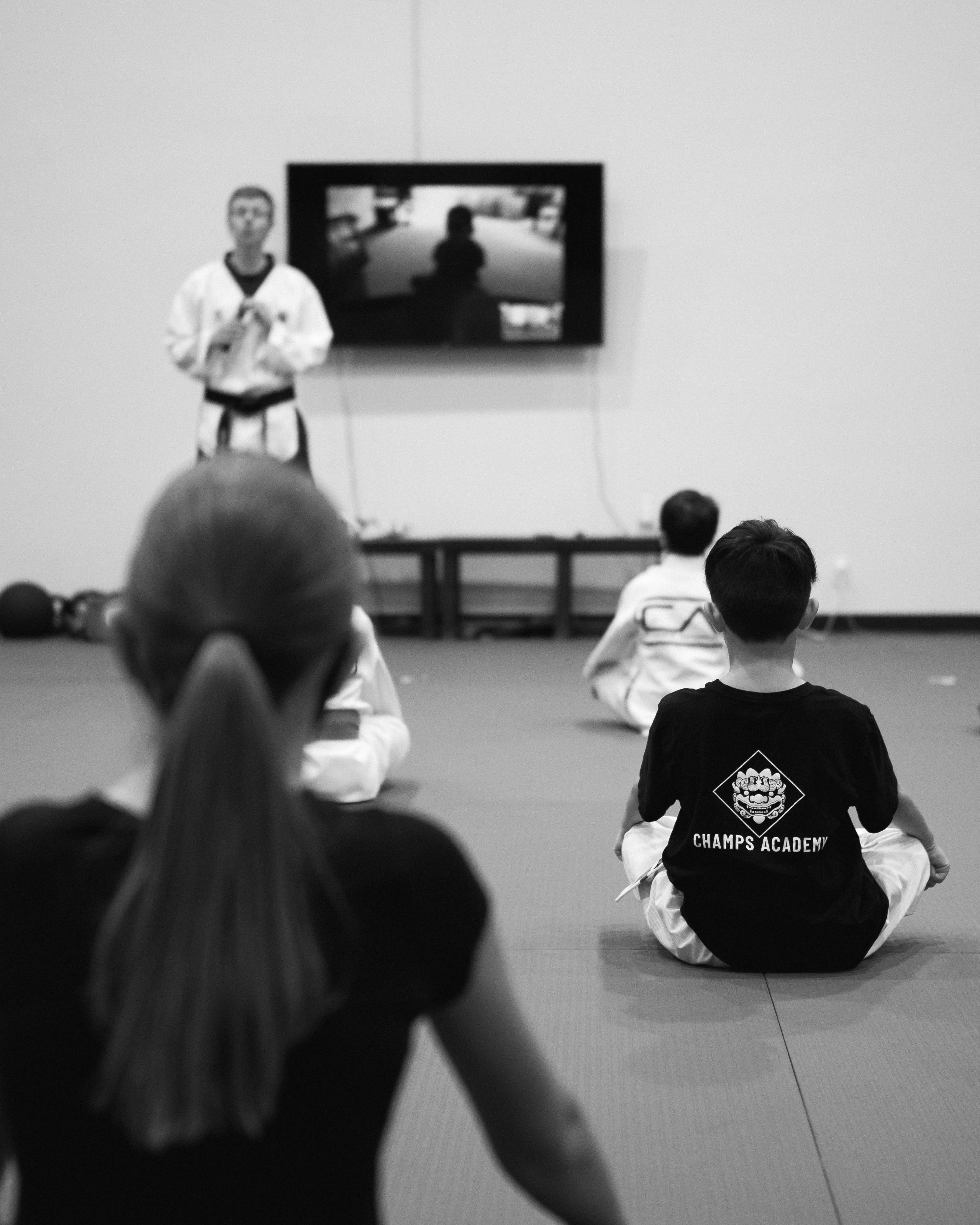 An instructor teaching a Taekwondo class