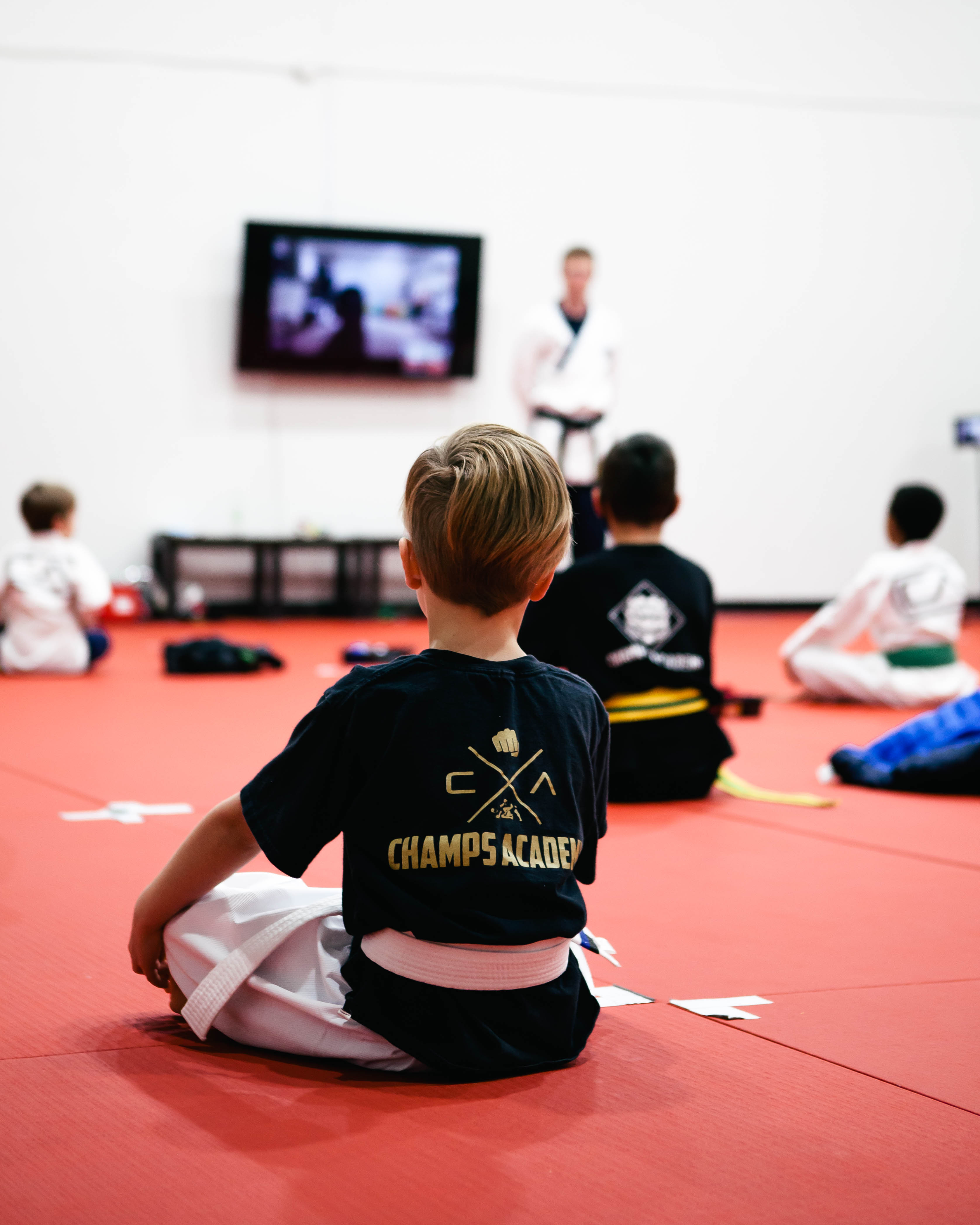 A kid paying attention in his martial arts class