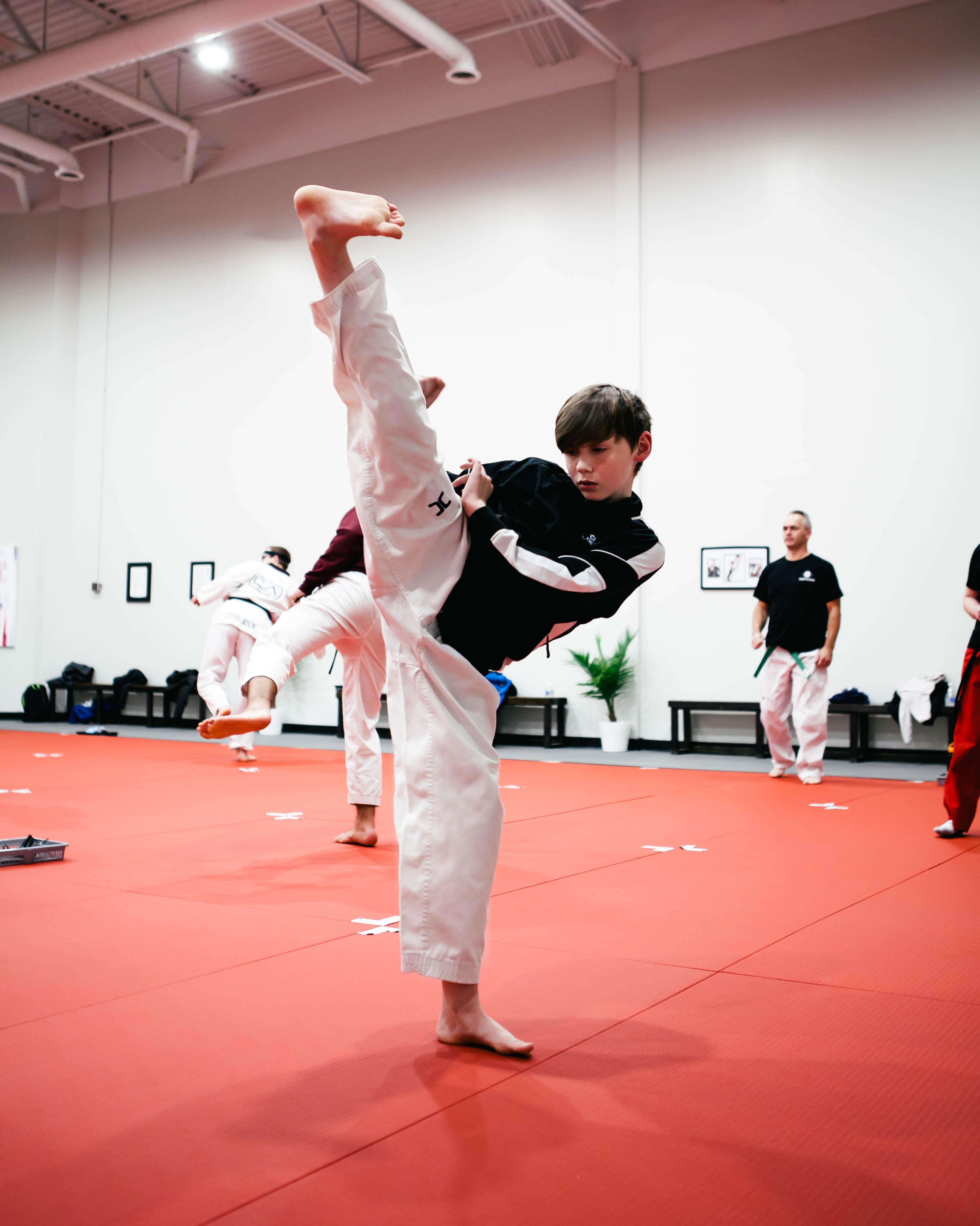 A kid learning Taekwondo