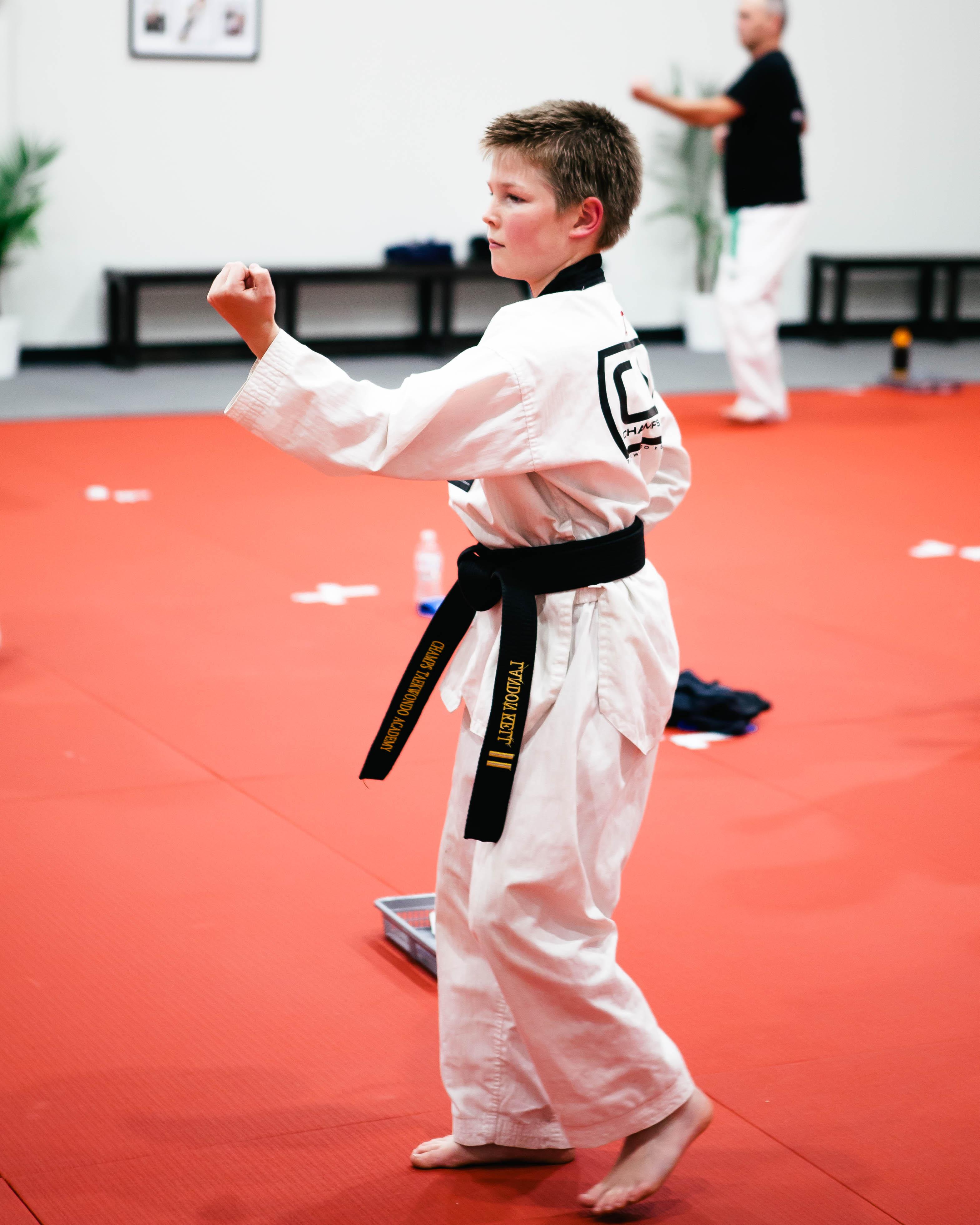 A kid practicing Taekwondo