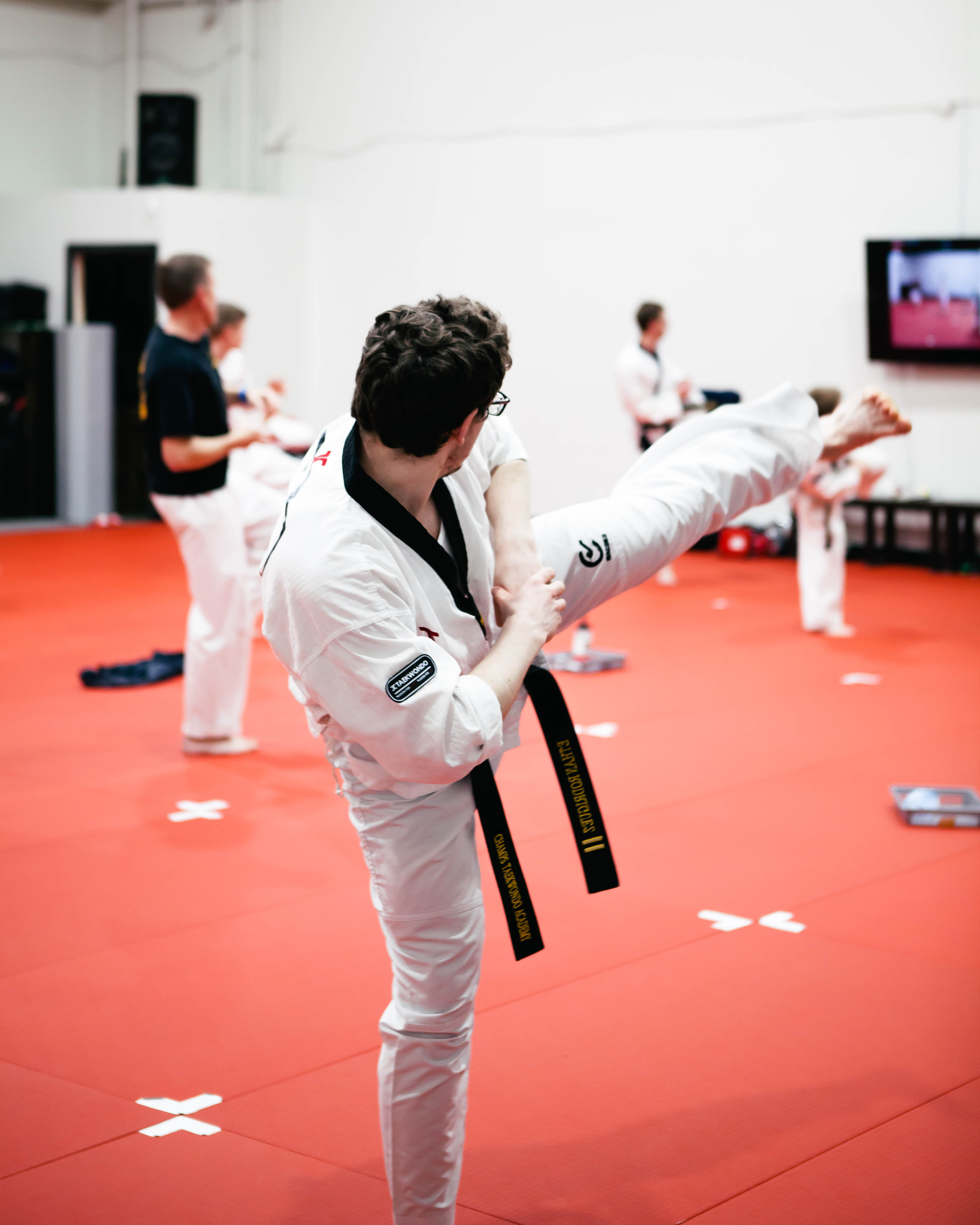 A teenager training Taekwondo