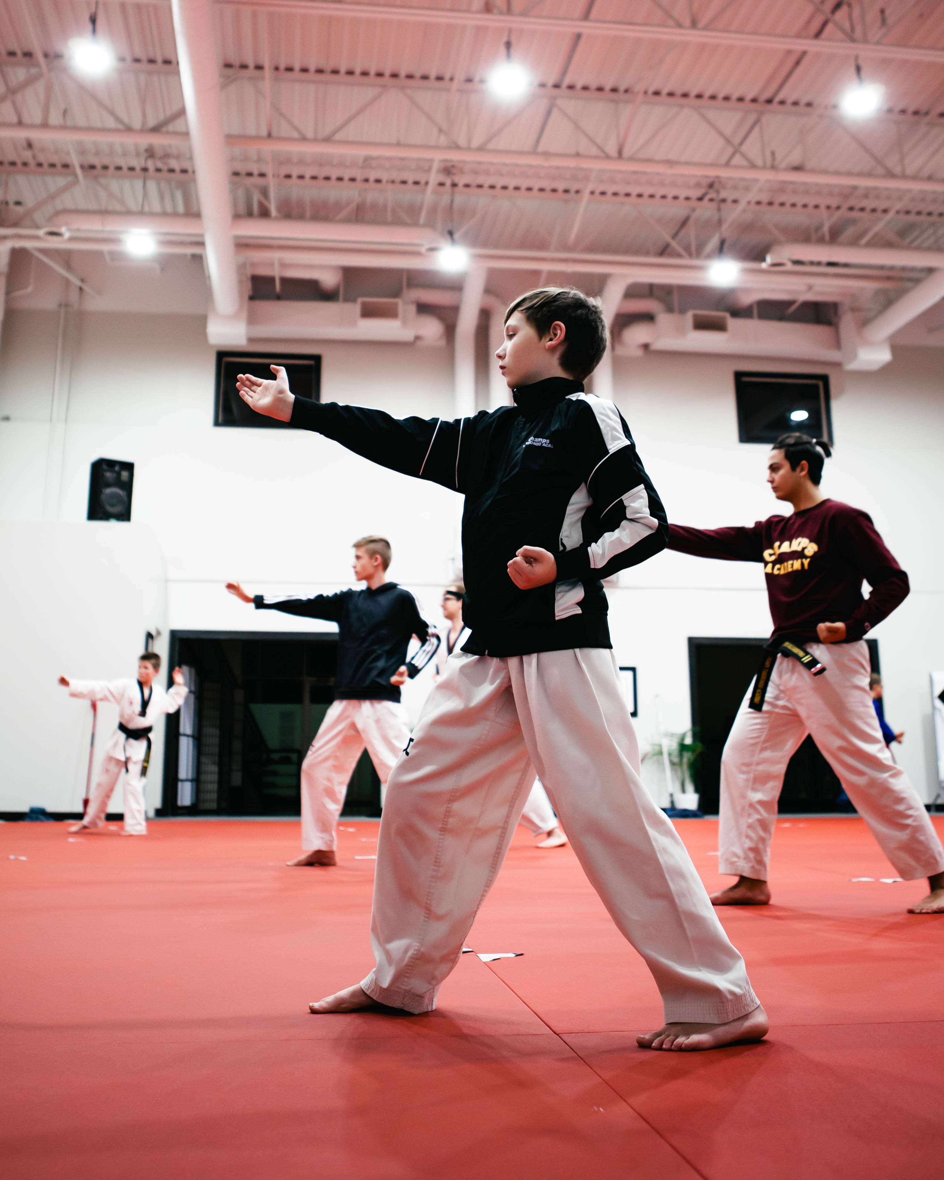 3 teenagers training Taekwondo