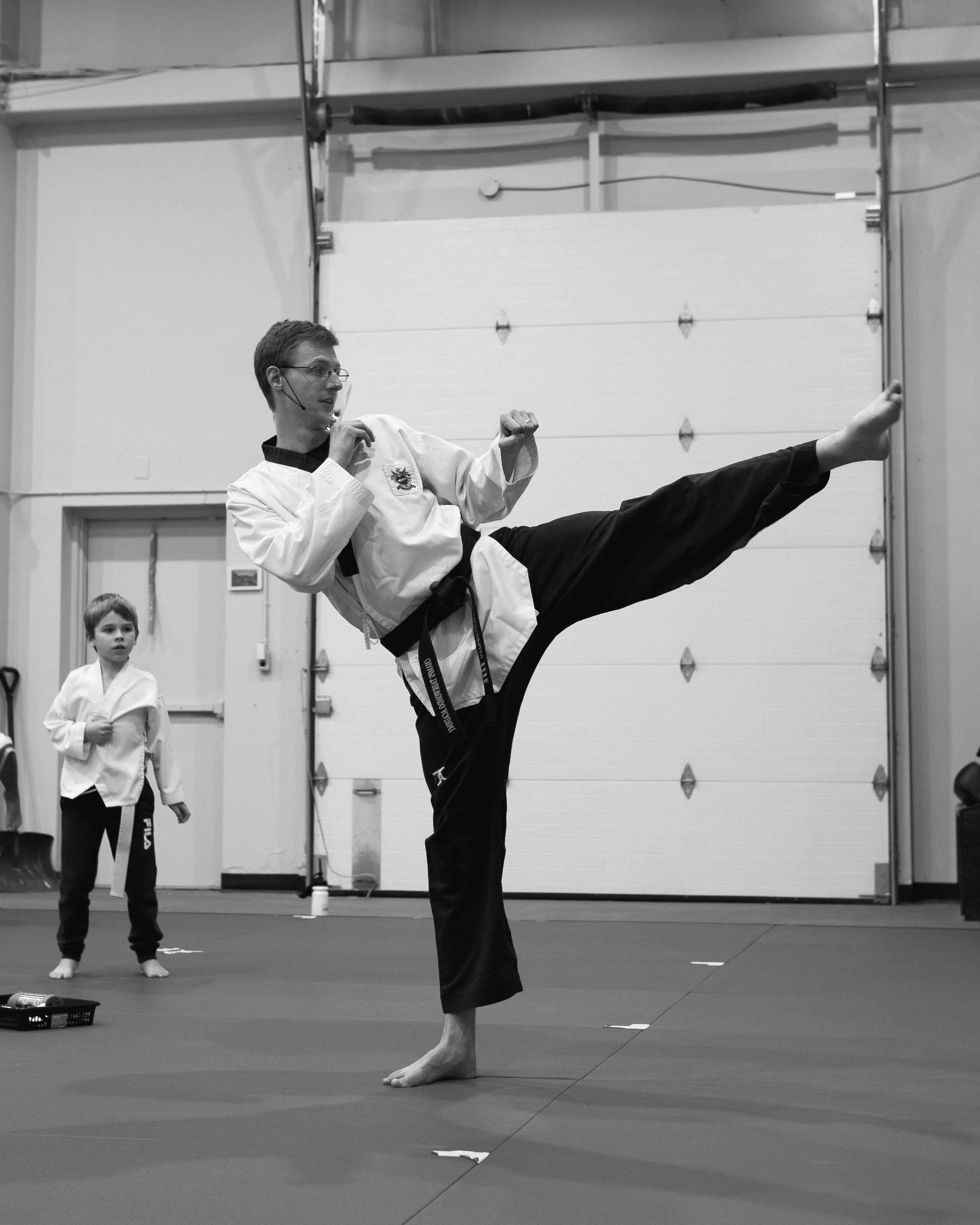 A teacher teaching Taekwondo to kids