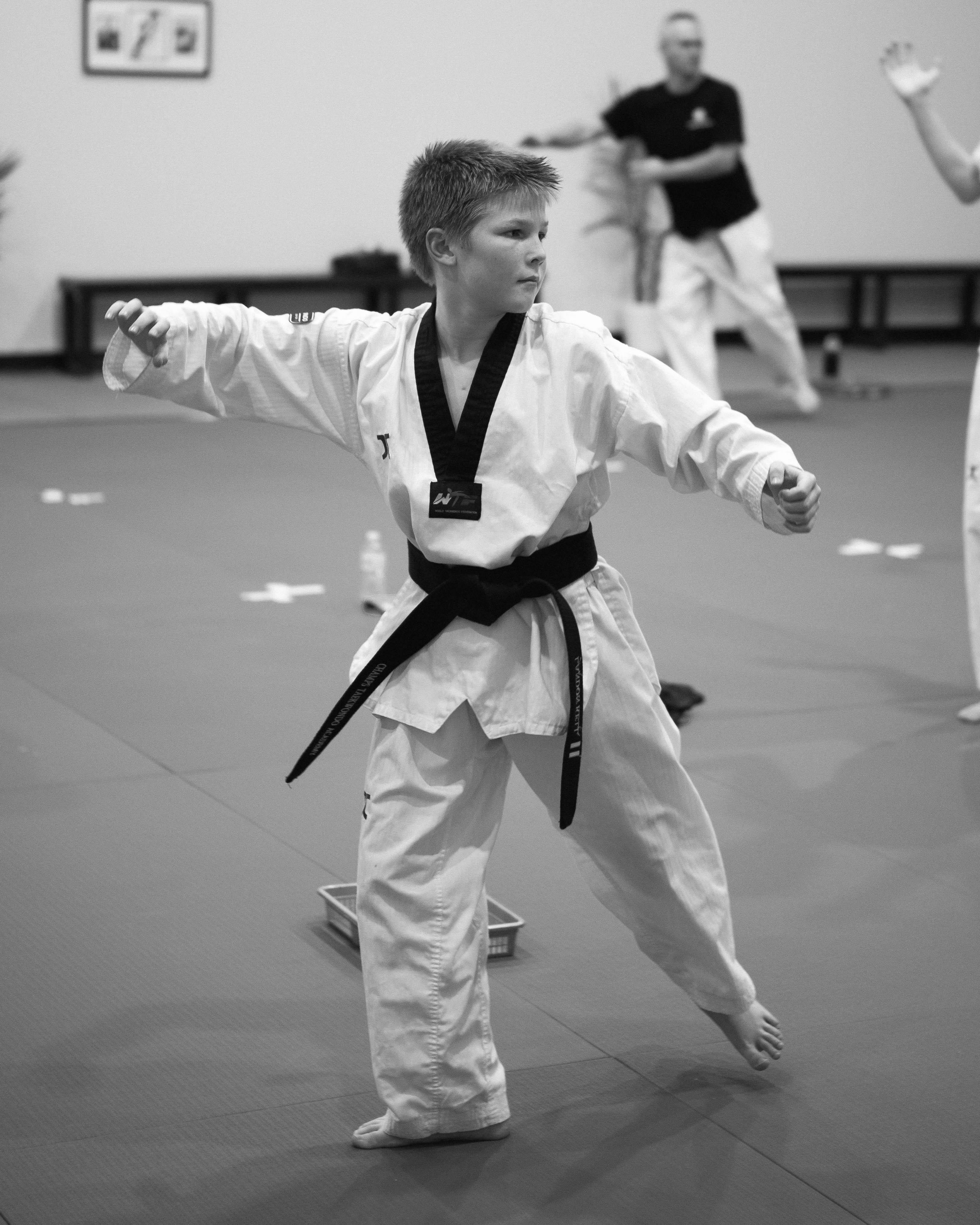 A teenager performing a Taekwondo poomsae