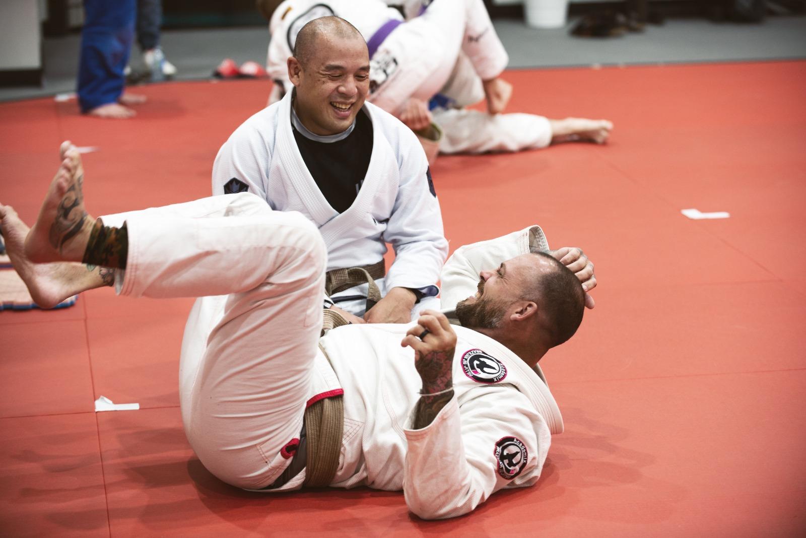 2 martial artists having fun training